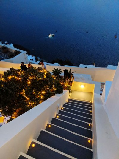 High angle view of illuminated steps by building against sky