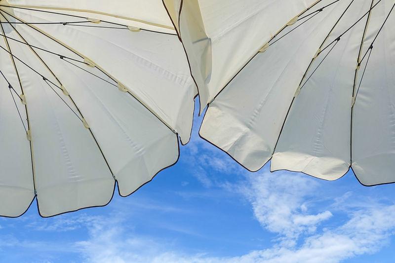 Clear Sky Summertime Beach Beach Day Beach Umbrella Cloud - Sky Day Low Angle View Nature Outdoors Sky Summer Sunbath Sunbathing Umbrella White Umbrellas