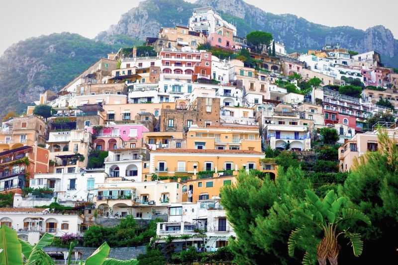 Positano, Italy. Building Exterior Architecture Mountain House Crowded Tree Day Outdoors Community City Travel Destinations Town Cityscape Nature Sky People Travel Destination Italy Positano, Italy Hillside Closeness Proximity Mediterranean  Marylandisforcrabs🦀
