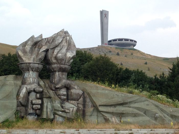 The torches sculpture on the way up to Buzludzha Buzludzha Architecture Beauty In Nature Building Exterior Built Structure Bulgaria Buzludzha Communist Monument Bulgaria Day Growth Landscape Monument Mountain Nature No People Outdoors Russian Sculpture Sculptures Sky Statue Torches Travel Destinations Tree