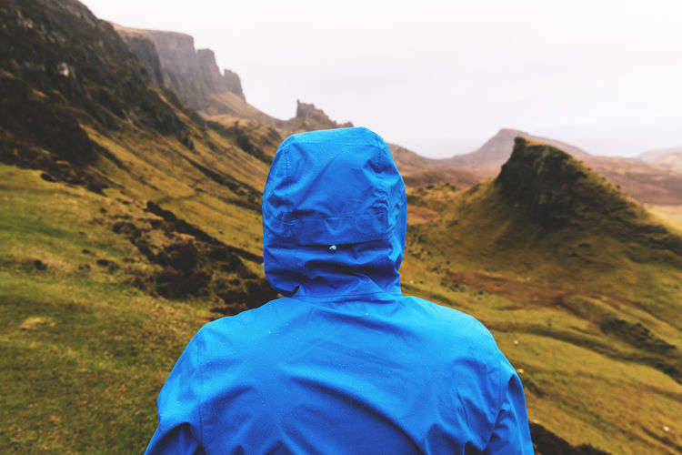 Rear view of person on mountain at quiraing