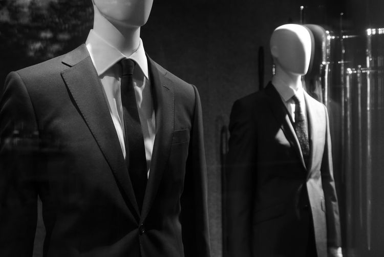 Mannequins with suit at shop window