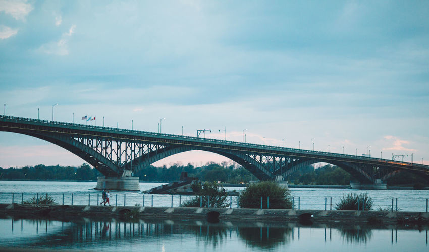 Arch Architecture Bridge Bridge - Man Made Structure Built Structure City Cloud - Sky Connection Day Engineering Nature No People Outdoors River Sky Transportation Water