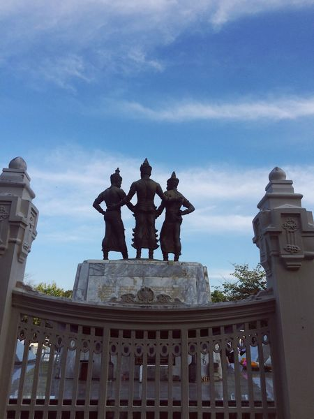 Architecture Human Representation Sculpture Sky Tourism Art And Craft Travel Destinations Statue Building Exterior Male Likeness Built Structure Travel Low Angle View History Cloud - Sky Outdoors Façade City Day Real People Three Kings Parade View From Behind King - Royal Person City Gate