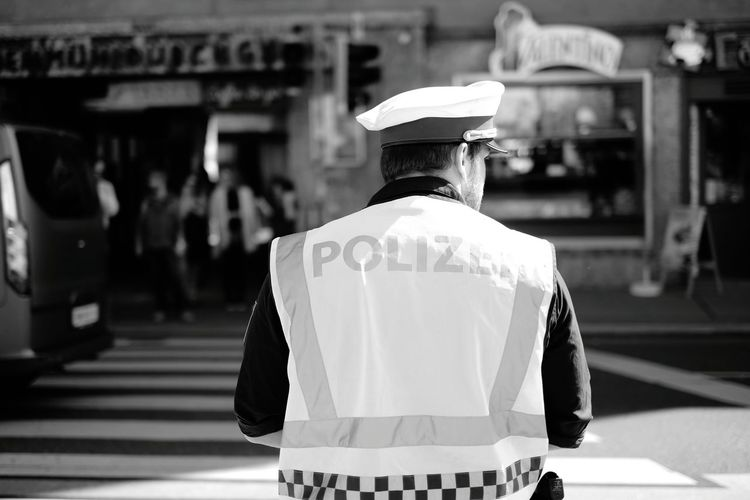 Rear view of police man on city street
