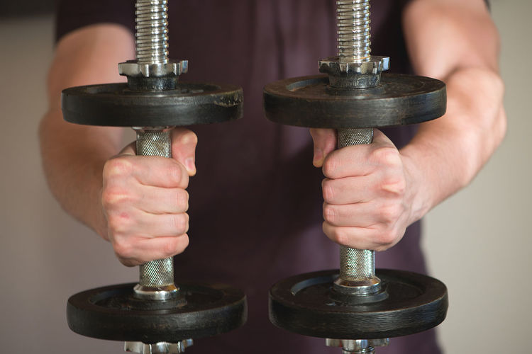 Close-up of hand holding dumbbells