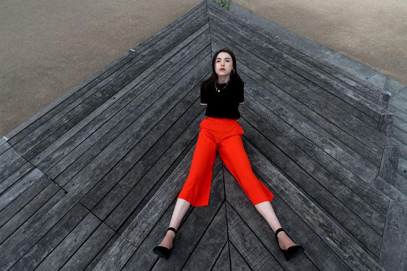 Portrait of woman on wooden floor