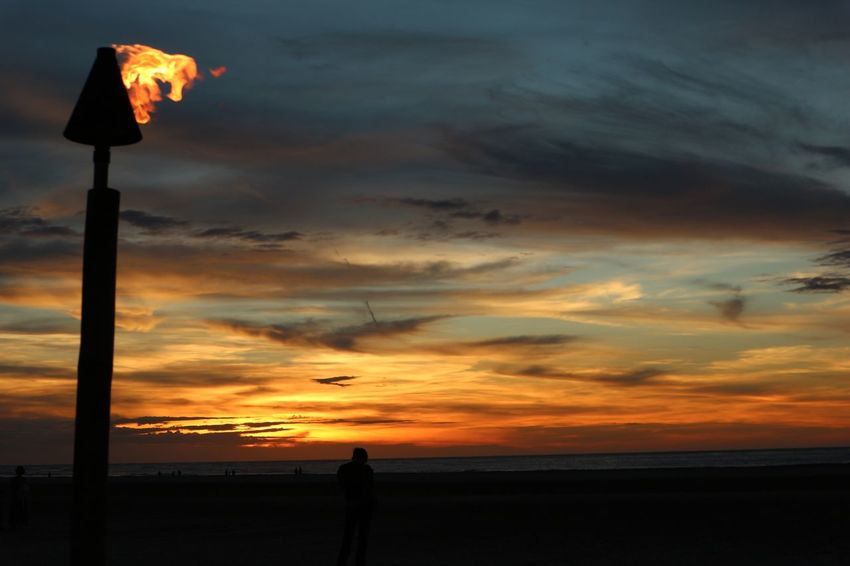Canon Eos 100D Kota Kinabalu Torchlight Sunset Orange Color Silhouette Beauty In Nature Nature Sea Dramatic Sky Scenics Sky Cloud - Sky Beach Water Tranquility Tranquil Scene Horizon Over Water Outdoors No People