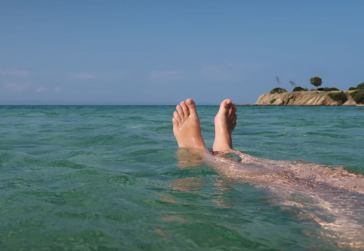Feet up in the sea Relaxing Sea Water Nature Real People Sky Relax Holiday Travel Feet Up Vacation Outdoors Swim Horizon Shallow Body Part One Person Human Foot Leisure Activity Horizon Over Water Human Leg Low Section Human Body Part Scenics - Nature barefoot Beauty In Nature Waterfront Relaxation Day