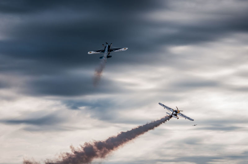 Aerobatics Air Vehicle Airplane Airshow Arrangement Cloud - Sky Cooperation Day Fighter Plane Flying Low Angle View Mid-air Military Airplane Mode Of Transport Motion No People Outdoors Performance Skill  Sky Smoke - Physical Structure Speed Teamwork Transportation Vapor Trail