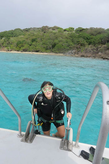Female scuba diver getting in to ocean Adventure Aged 40-45 Boat Challenge Day Exploration Fun Hobbies Leisure Activity Lifestyles Mask Person Scuba Diving Sea Selfie US Virgin Isles Vacations Vitality Water Wetsuit Woman