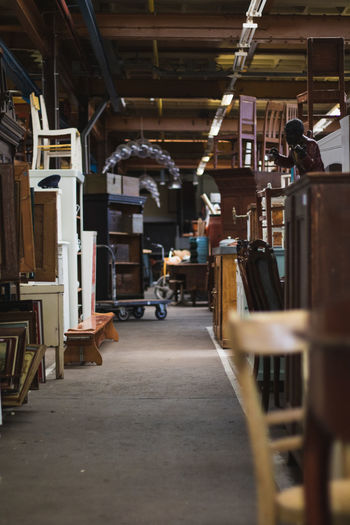 Vintage stores and old furniture Vintage Store Old Furniture Indoors  Large Group Of Objects Architecture Business Industry Incidental People Real People In A Row Wood - Material Warehouse The Way Forward Building Day Domestic Room Shelf Selective Focus One Person Factory Absence Aisle Vintage