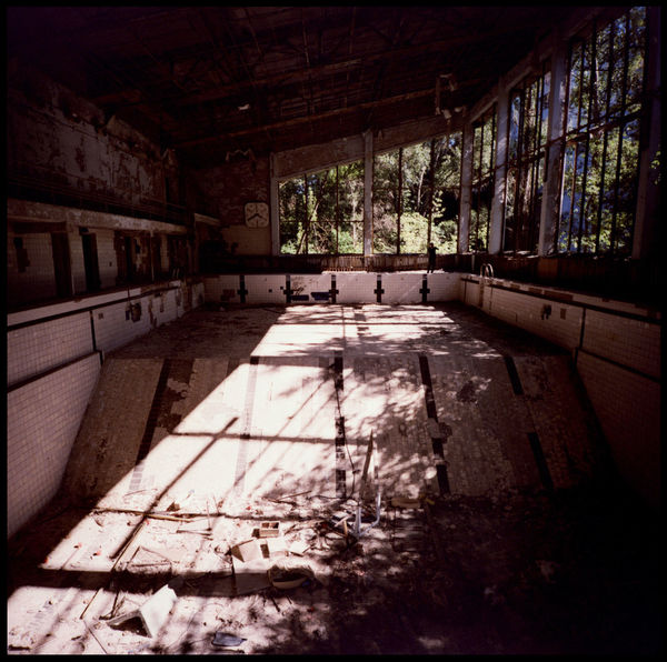 The abandonded pool of Pripyat After The Fall Apocalypse Broken Piano Girls Shower Jumping Block Lomography Pripyat Radioactive Soviet Union Swim Block Abandonded Abandonded Pool Broken Broken Staircase Cccp Chernobyl Exclusion Zone Empty Pool Exclusion Zone Medium Format Nuclear Disaster Pool Red Flag Run Down Start Block Xpro