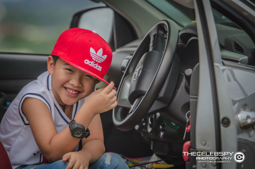 Boys Cap Car Casual Clothing Child Childhood Front View Innocence Land Vehicle Lifestyles Males  Men Mode Of Transportation Motor Vehicle One Person Portrait Real People Red Transportation