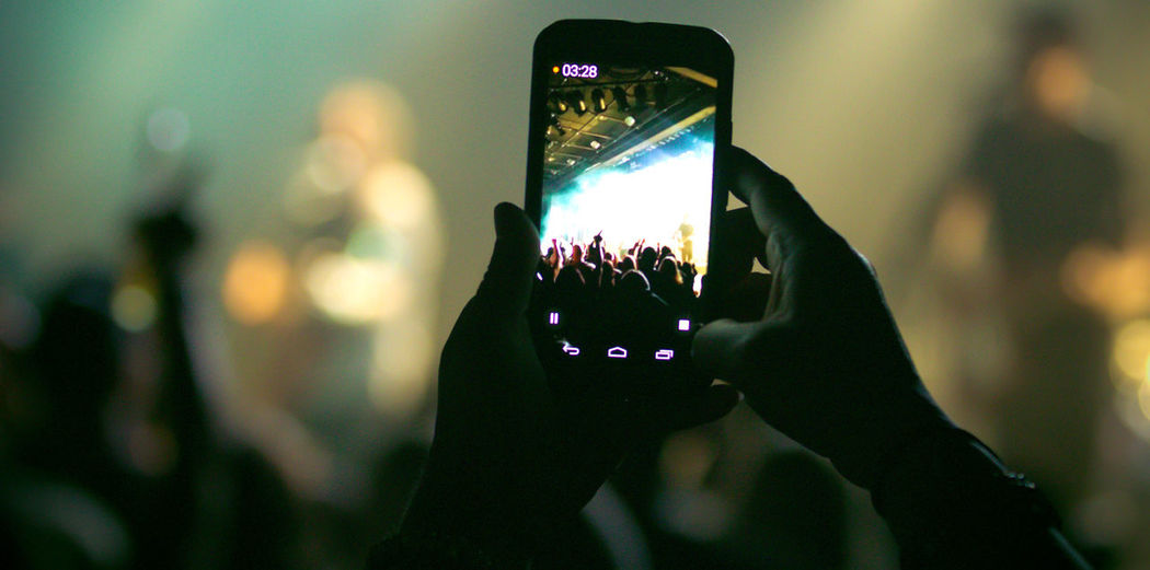 Cropped Image Of Person Photographing At Music Concert