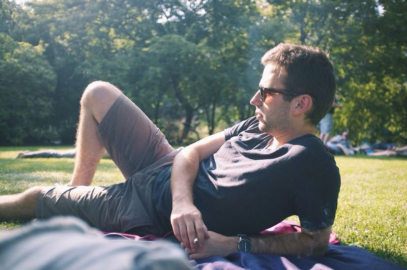 Young man relaxing in a park