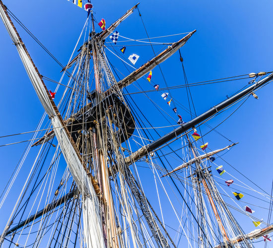 The rigging and ropes of a tall ship Blue Clear Sky Day Flag Mast Mode Of Transport Nautical Vessel No People Outdoors Pendants Red Rigging Rope Sky Tall Ship Transportation