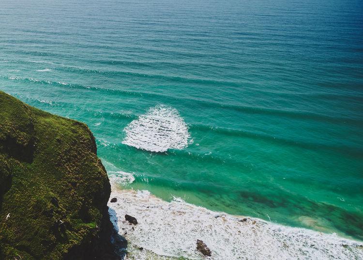 High angle view of rocks on beach near bedruthan steps