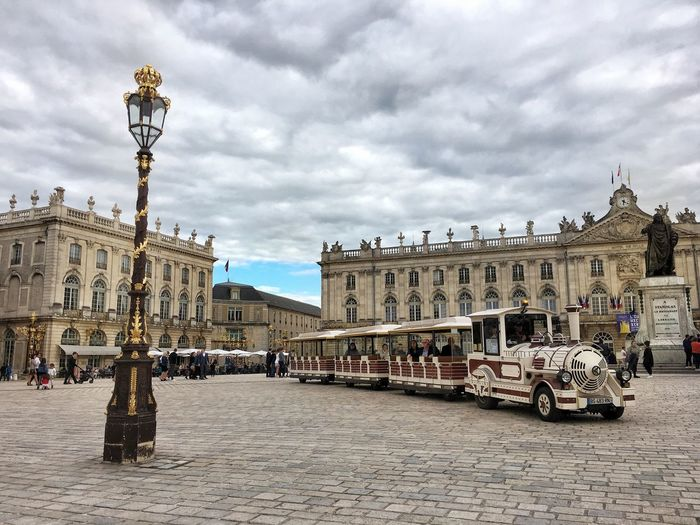 Short stop in Nancy, in Region Lorraine (Eastern France) and especially at Place Stanislas, the most famous square of the city. It was built according to the wishes of Stanisław Leszczyński, who was King of Poland 🇵🇱, Duke of Lorraine, and King Louis XV's father-in-law. The square was inaugurated in 1755! Perfect place to taste and enjoy some Lorraine specialties, like quiche and pies! 😉 Building Exterior Sky Cloud - Sky Outdoors Architecture Statue History Day Travel Destinations City Train Square IPhoneography France Lorraine Photooftheday