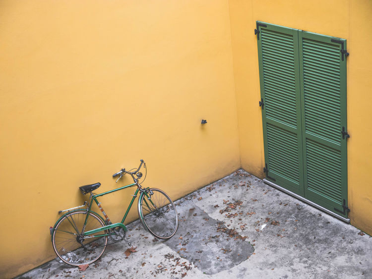 Loneliness Yellow Green Architecture Bicycle Day Green Bycycle Green Doors Green Shutters No People Outdoors Yellow Yellow Walls