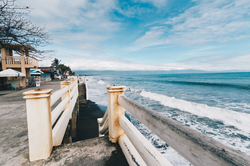 Baler is one of the best surfing place in the Philippines! Baler Beauty In Nature Cloud - Sky Day Nature No People Outdoors Philippines Railing Scenics Sea Sky Travel Destinations Water Wheelchair Access First Eyeem Photo