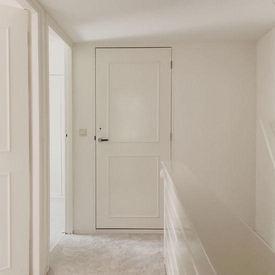 Closed door in hallway at home