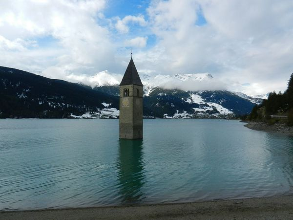 Water Mountain Architecture Built Structure Lake Tranquil Scene Mountain Range Tranquility Building Exterior Sky Cloud - Sky Scenics River Tower Outdoors Nature Bell Tower - Tower Bell Tower No People Non-urban Scene Church Surreal Reschensee Lago Di Resia (Reschensee) Traveling