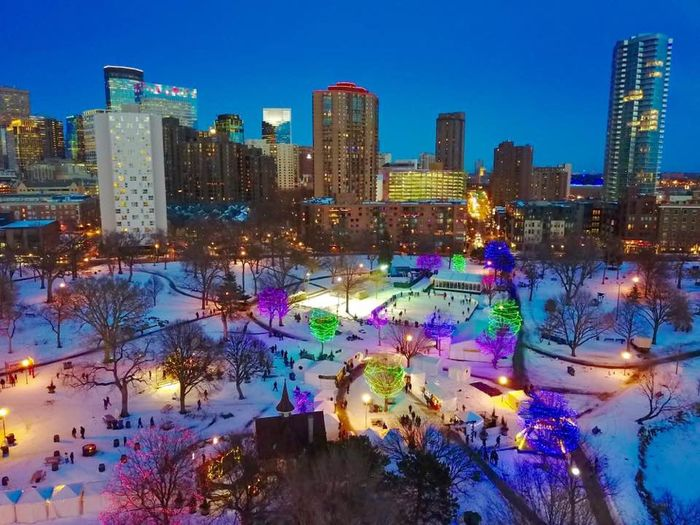 Blue Hour aerial drone view of Holidazzle Festival in Loring Park, Minneapolis, MN USA Aerial Architecture Blue Hour Building Exterior Celebration City Cityscape Crowd Downtown District Drop Festival Holidazzle Holidazzle Parade Illuminated Loring Park Minneapolis Modern Multi Colored Outdoors Park Skating Skyscraper Urban Skyline Water