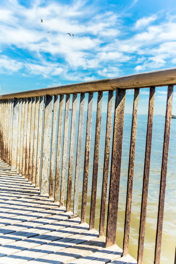 Architecture Beach Bridge - Man Made Structure Cloud - Sky Day Forward Guided No People Outdoors Railing Sea Sky Sunlight Wood - Material