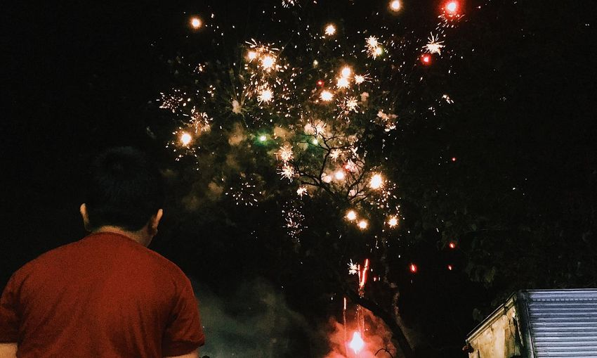 [ Goodbye 2018 一 Hello 2019🎇 ] people and places People Watching Perspective From My Point Of View New Beginnings New Year Night Illuminated Celebration Firework Event Firework Display Glowing Low Angle View Motion Exploding Firework - Man Made Object Outdoors