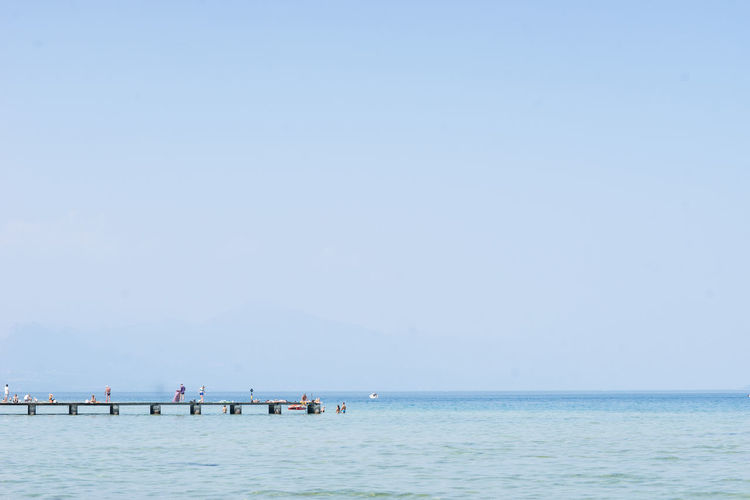 Beach Beauty In Nature Blue Clear Sky Copy Space Day Horizon Over Water Nature Nautical Vessel Outdoors Scenics Sea Sky Small People Small People Far Away Tranquil Scene Tranquility Travel Destinations Vacations Water