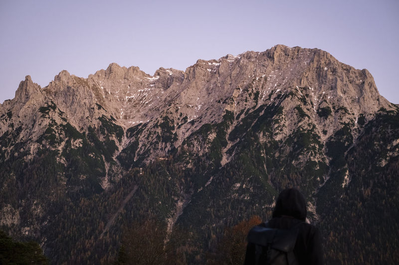 Rear view of woman looking at mountain range