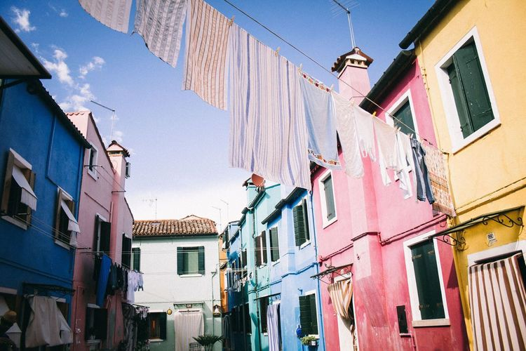 Building Exterior Architecture Built Structure Building Low Angle View Residential District Hanging Window Day Clothing Drying Clothesline Laundry Nature No People City Sky Outdoors Textile Sunlight Alley Row House Burano, Italy Burano Burano, Venice