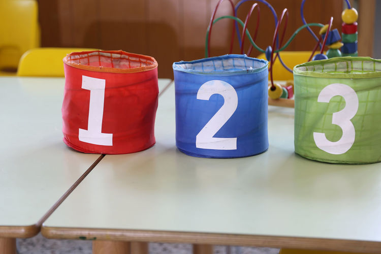 Containers with numbers on table