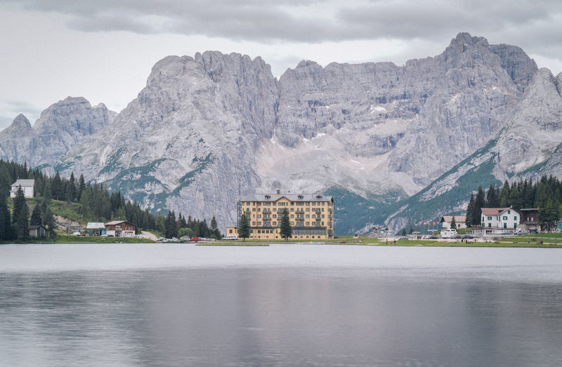 A classic alpine shot Architecture Beauty In Nature Building Building Exterior Built Structure Cloud - Sky Cold Temperature Day Formation Lake Mountain Mountain Peak Mountain Range Nature No People Outdoors Scenics - Nature Sky Snowcapped Mountain Travel Destinations Water Waterfront