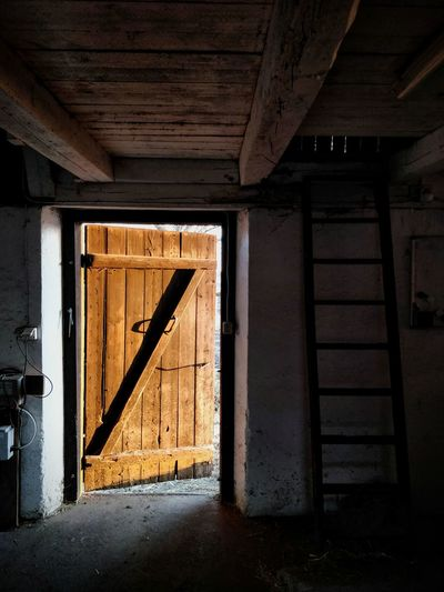 Ajar. Warm Colors Door Doorway Stable Thick Confined Space Abandoned Home Interior Wood - Material Architecture Close-up Weathered