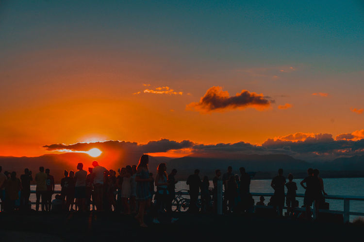 sunset Beauty In Nature Cloud - Sky Crowd Large Group Of People Leisure Activity Lifestyles Men Nature Orange Color Outdoors People Real People Scenics Silhouette Sky Standing Sunset Sunset_collection Sunsets Togetherness Women