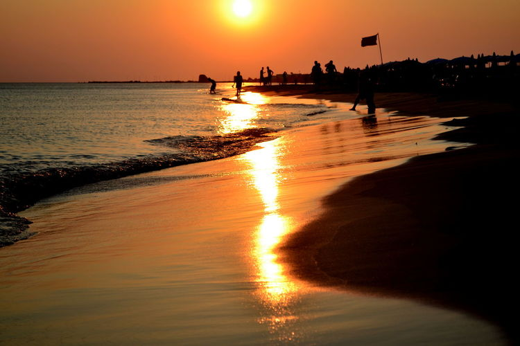 Sunset_collection Beach Beauty In Nature Horizon Over Water Large Group Of People Lifestyles Men Nature Orange Color Outdoors Peolpe People Real People Reflection Scenics Sea Silhouette Sky Sun Sunlight Sunset Tranquility Vacations Water Wave