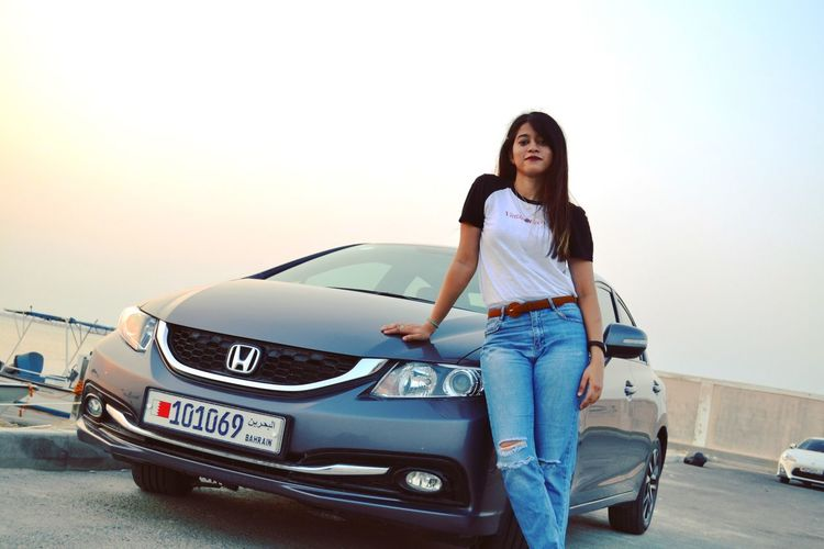 EyeEmNewHere Converse Bershka Zara Beach Honda Honda Civic women around the world Women Photographers Nikon Nikonphotography EyeEmNewHere Bahrain Motor Vehicle Car Transportation Mode Of Transportation One Person Standing Casual Clothing Women Sky Jeans Lifestyles Portrait