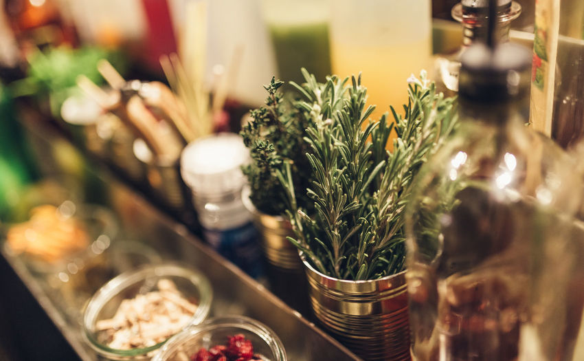 Herbs and aromatic ingredients in a cocktail bar Selective Focus Plant Herb Indoors  No People Container Food And Drink Close-up Restaurant Bare Tree Cocktail Cocktails Cocktail Bar Herbs Ingredient Botanical