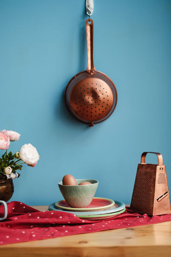 Easter table still life on blue background Table Eggs Vintage Easter Household Equipment Wall - Building Feature Colored Background Indoors  No People Food And Drink Kitchen Utensil Food Still Life Spoon Mug Close-up Freshness Wood - Material Kitchen Eating Utensil Blue Easter Ready Copy Space Cooking At Home Cooking