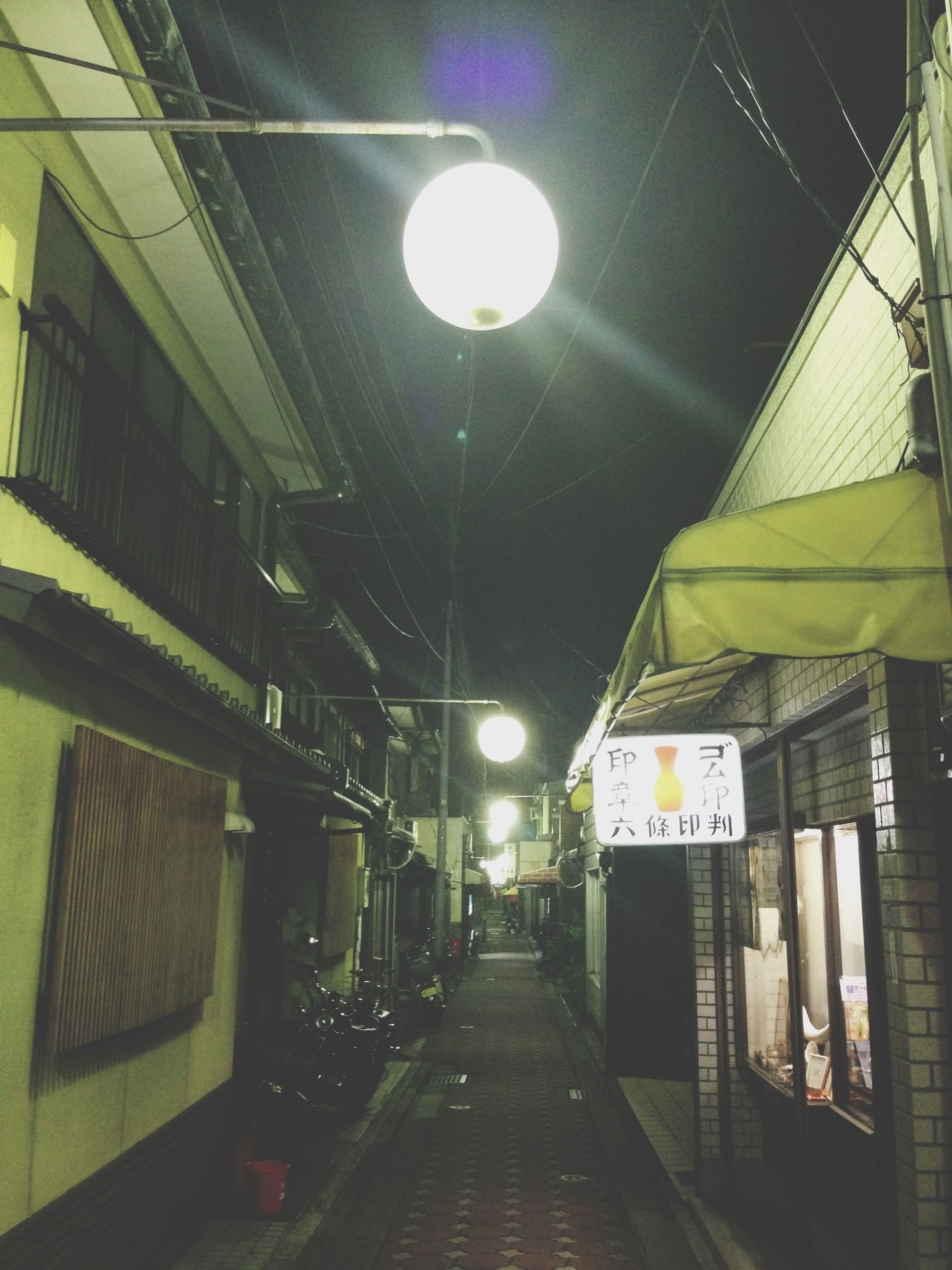 illuminated, lighting equipment, architecture, built structure, the way forward, night, electricity, ceiling, diminishing perspective, electric light, building exterior, street light, transportation, vanishing point, empty, indoors, building, light - natural phenomenon, no people, long