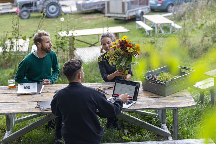 People sitting on table at yard