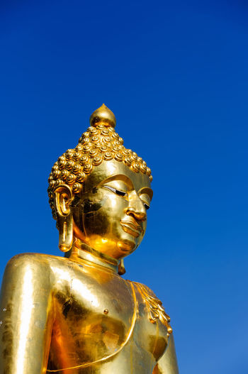 Art And Craft Belief Blue Clear Sky Copy Space Creativity Gold Gold Colored Human Representation Idol Low Angle View Male Likeness No People Ornate Religion Representation Sculpture Sky Spirituality Statue