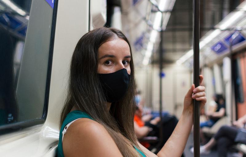 Portrait of woman standing in train