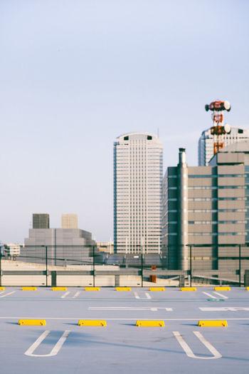 Modern city against clear sky