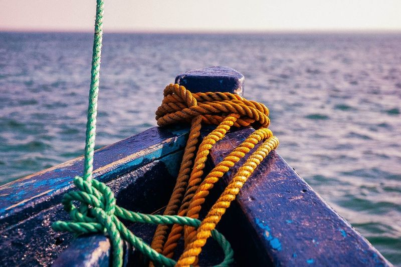 Close-up of rope tied on boat in sea