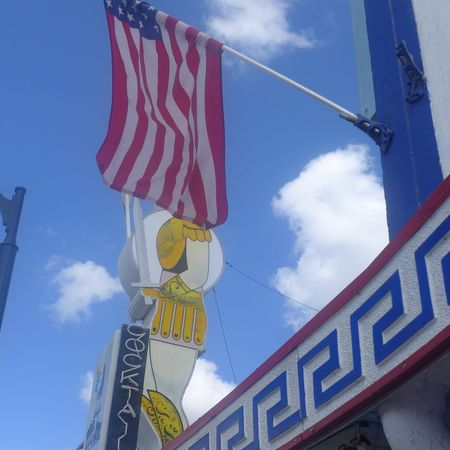 Tarpon Springs USA. Flag Low Angle View Patriotism Sky Blue Cloud - Sky Day Outdoors Multi Colored No People Politics And Government