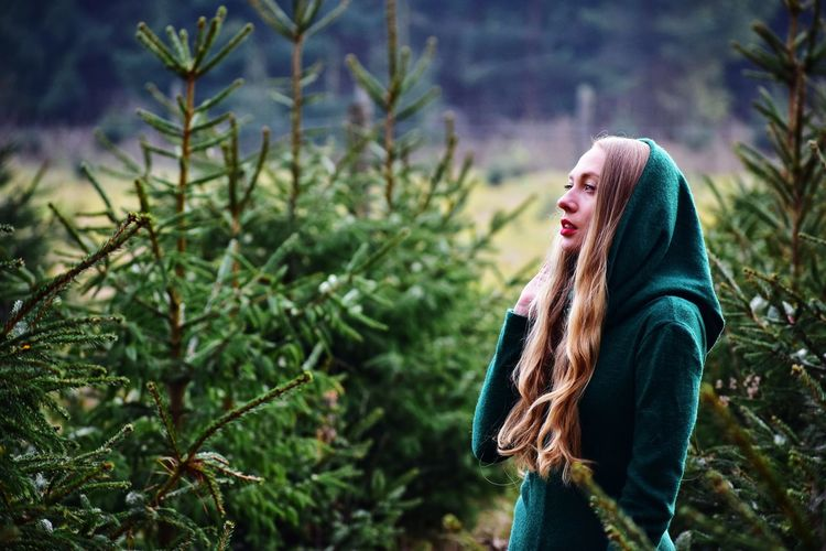 woman in green dress in autumn forest Fur Tree Green Dress Woman Girl Warm Clothing Women Happiness Smiling Winter Cheerful Cold Temperature Young Women Beauty Tree Fall Autumn