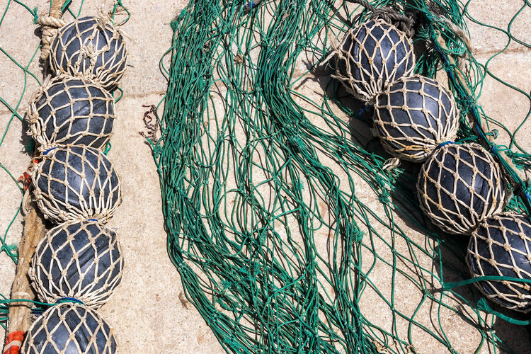 High angle view of fishing net at beach